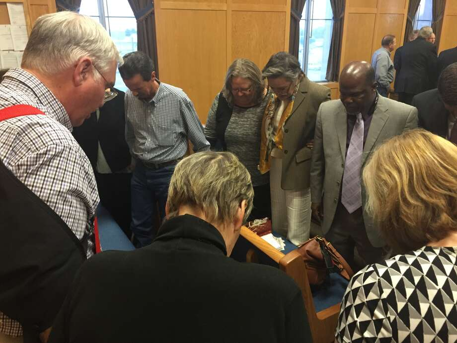Members of Citizens Against the Landfill in Hempstead gathered to pray in the courtroom after the jury's verdict, Oct. 18.