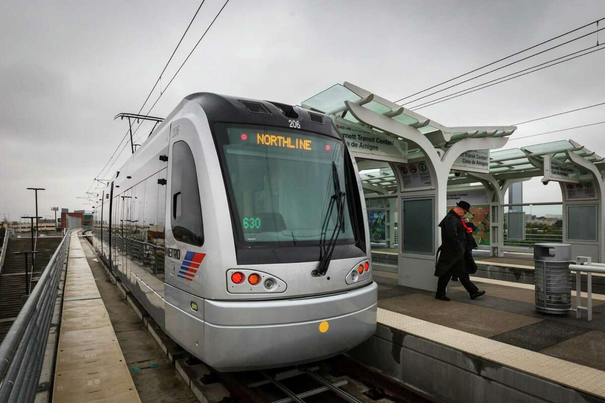 METRORail's second-generation H2 train, shown stopping at the Burnett Transit Center, has been running on the North/Red Line for about a year.