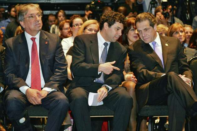 Rivers Casino partners David Buicko, left of the Galesi Group, and Greg Carlin of Rush Street Gaming sit with Gov. Andrew Cuomo, right, during a celebration of the selection of Schenectady as the Capital Region site for the Rivers Casino at Mohawk Harbor Thursday, Dec. 18, 2014, in the GE Theatre at Proctors in Schenectady, NY.  (John Carl D'Annibale / Times Union) Photo: John Carl D'Annibale / 00029921A