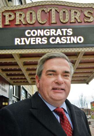 Schenectady Mayor Gary McCarthy stops beneath the Proctor's marquis on his way to a celebration of the selection of Schenectady as the Capital Region site for the Rivers Casino at Mohawk Harbor Thursday, Dec. 18, 2014, in Schenectady, NY.  (John Carl D'Annibale / Times Union) Photo: John Carl D'Annibale / 00029921A
