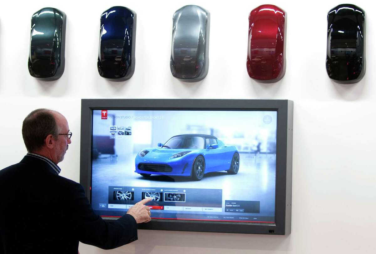 George Blankenship shows off his company's electric cars at the Tesla Gallery in the Galleria in 2011.