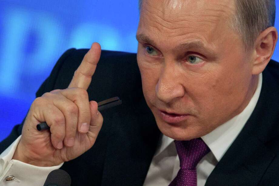 Russian President Vladimir Putin gestures during his annual news conference in Moscow, Russia, Thursday, Dec. 18, 2014. The Russian economy will rebound and the ruble will stabilize, Russian President Vladimir Putin said Thursday at his annual press conference, he also said Ukraine must remain one political entity, voicing hope that the crisis could be solved through peace talks. (AP Photo/Pavel Golovkin) ORG XMIT: MOSB117 Photo: Pavel Golovkin / AP