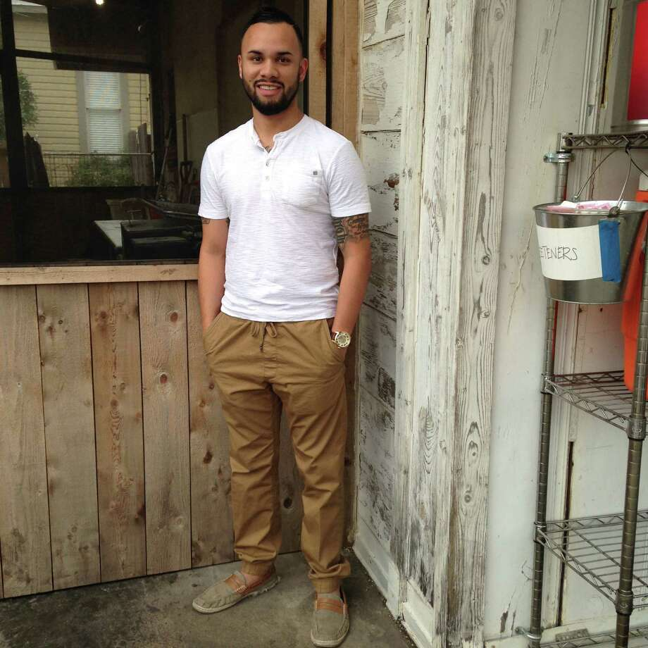Adrian Gomez shows off his easy style with a Henley T-shirt over drawstring jogger trousers and frayed canvas loafers. The look is inspired by his oversized watch, one of 16 he owns and often builds an outfit around. Photo: Michael Quintanilla/San Antonio Express-News