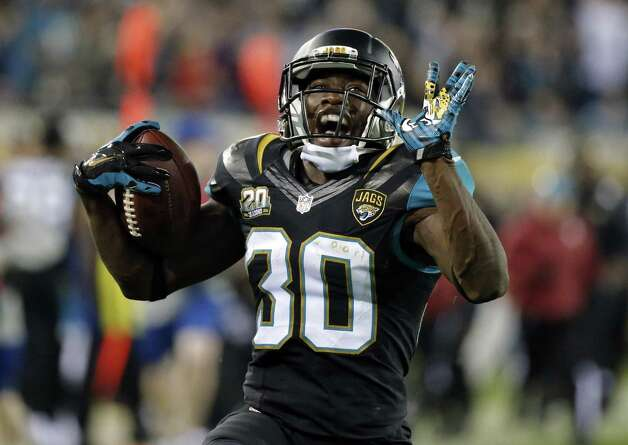 Jacksonville Jaguars running back Jordan Todman (30) smiles as he runs 62 yards for a touchdown against the Tennessee Titans during the fourth quarter of an NFL football game Thursday, Dec. 18, 2014, in Jacksonville, Fla. (AP Photo/Stephen B. Morton)  ORG XMIT: JVS213 Photo: Stephen B. Morton / FR56856 AP