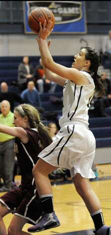 Cohoes' Nerea Brajac, right, goes to the hoop during their basketball game against Fonda on Thursday Dec. 18, 2014, at Cohoes High in Cohoes, N.Y. (Cindy Schultz / Times Union) Photo: Cindy Schultz / 00029920A