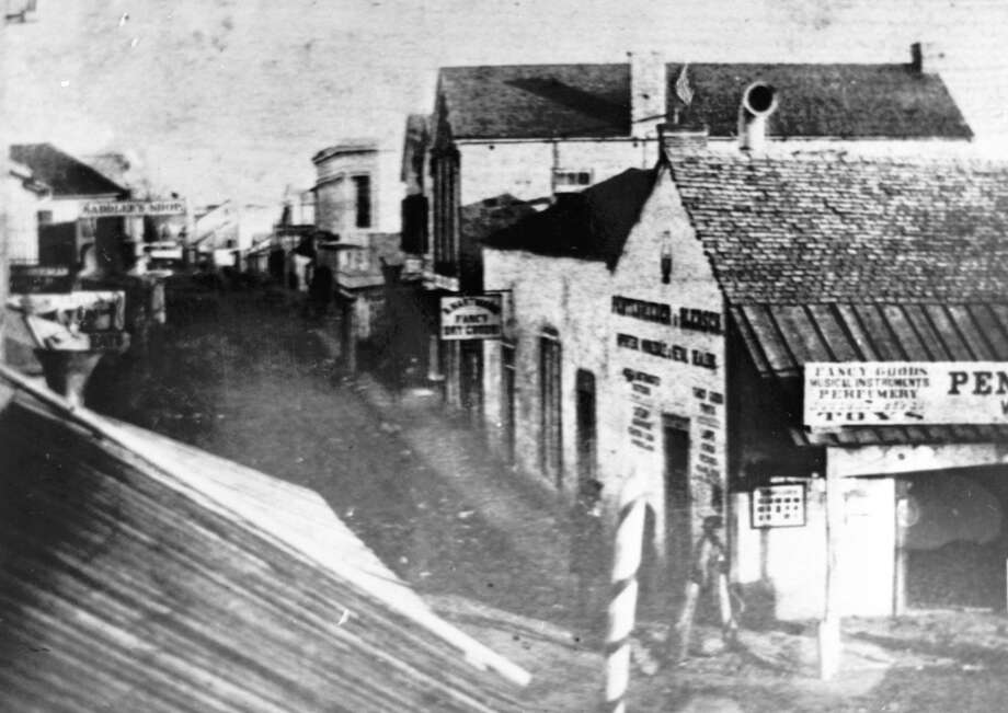 Ernst Raba, a photographer in the 19th century, captured this image of the vicinity where the San Antonio Express had its first office at 138 E. Commerce St. The photo was taken about the time the Express was launched in 1865. Photo: San Antonio Conservation Society / Raba Collection