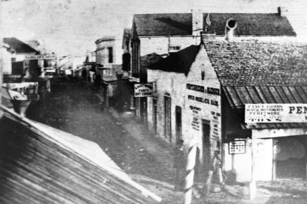 Ernst Raba, a photographer in the 19th century, captured this image of the vicinity where the San Antonio Express had its first office at 138 E. Commerce St. The photo was taken about the time the Express was launched in 1865.