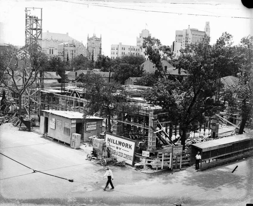 Construction underway on the San Antonio Light building on Broadway at McCullough Avenue. The San Antonio Express-News building can be seen in the center of the background, partly obscured by a tree branch.