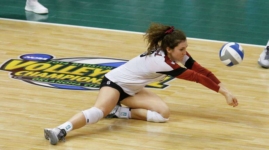 Stanford's Jordan Burgess hits during an NCAA women's volleyball tournament semifinal against Penn State in Oklahoma City, Thursday, Dec. 18, 2014. Penn State won to advance to the finals. (AP Photo/Sue Ogrocki) Photo: Sue Ogrocki / Associated Press / AP