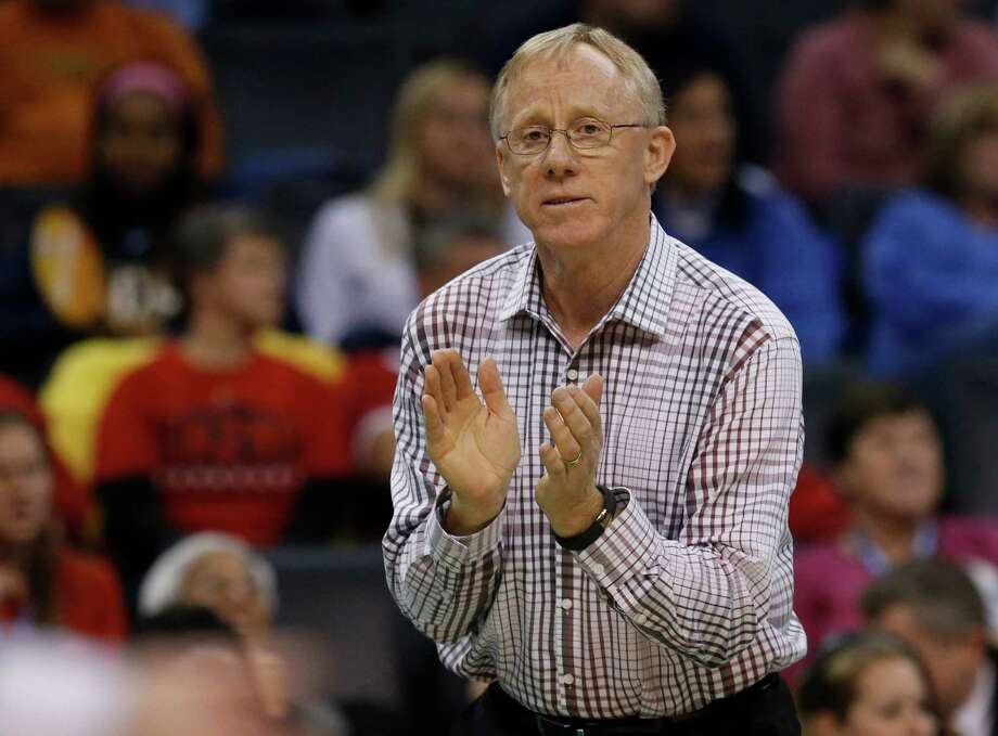 Stanford head coach John Dunning claps on the sideline during an NCAA college volleyball tournament semifinal against Penn State in Oklahoma City in this file photo from Dec. 18, 2014. Photo: Sue Ogrocki / Associated Press / AP