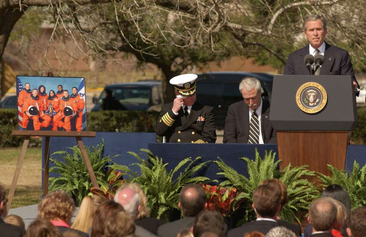 President George W. Bush speaks at Columbia memorial Bush spoke at the Johnson Space Center on Feb. 4 2002, at a memorial service for the crew members of the Space Shuttle Columbia. The shuttle disintegrated while re-entering the Earth's atmosphere, killing all seven astronauts on board.