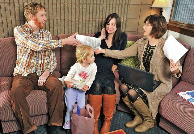 College professors Joseph Creamer, left, and Melissa Tracy and their daughter Cecelia, 4, meet with Tech Valley Connect program coordinator Joann Bucher, right, at the Tech Valley Connect offices in Troy, NY. Photo: John Carl D'Annibale, John Carl D'Annibale / Women@Work / 00029423A