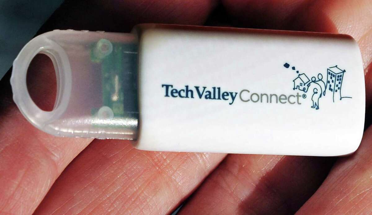 Tech Valley Connect e-binder USB drive with program information for clients at their offices.