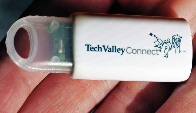 Tech Valley Connect e-binder USB drive with program information for clients at their offices. Photo: John Carl D'Annibale, John Carl D'Annibale / Women@Work / 00029423A