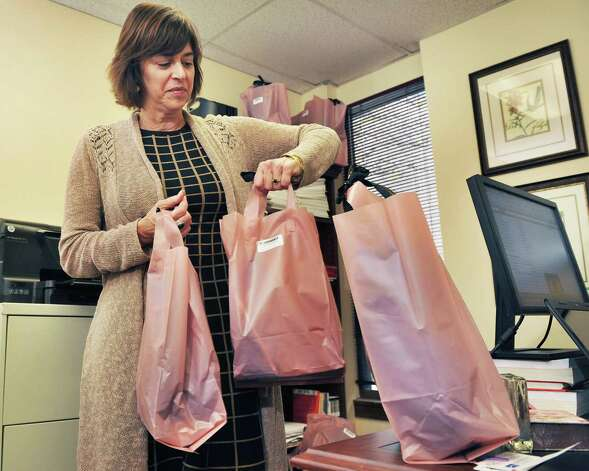 Tech Valley Connect program coordinator Joann Bucher with gift bags for clients donated by Mazzone Hospitality in her office Friday Nov. 14, 2014, in Troy, NY. Photo: John Carl D'Annibale, John Carl D'Annibale / Women@Work / 00029423A