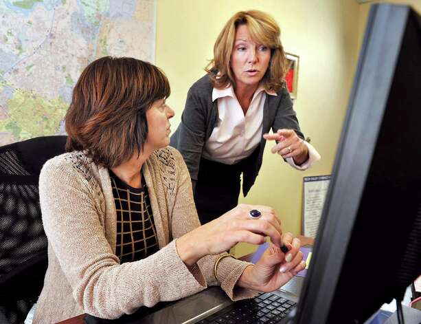Tech Valley Connect program coordinator Joann Bucher, left, and company president Angela McNerney at work in their offices in Troy, NY. Photo: John Carl D'Annibale, John Carl D'Annibale / Women@Work / 00029423A