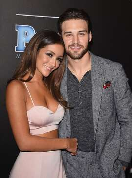 Actors Melanie Iglesias (L) and Ryan Guzman attend the PEOPLE Magazine Awards at The Beverly Hilton Hotel on December 18, 2014 in Beverly Hills, California.