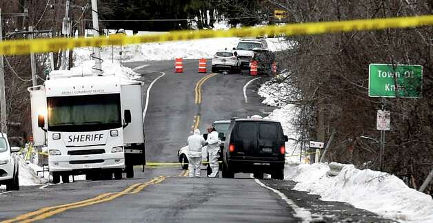 Thacher Park Road is closed Friday morning Dec. 19, 2014, as investigators continue their work to determine the cause of death of Kenneth White, 5, in Knox, N.Y.     (Skip Dickstein/Times Union) Photo: SKIP DICKSTEIN / 00029922A