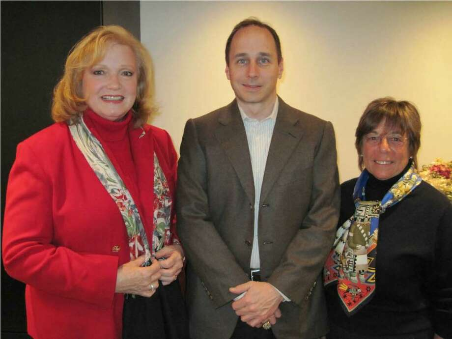 Event co-chairs and Family Centers board members Jan Dilenschneider of Darien, left, and Marge Berkley of Greenwich with New York Yankees general manager Brian Cashman on Feb. 12 during a fundraising breakfast to benefit Family Centers' children's programs. Photo: Contributed Photo / Greenwich Time Contributed