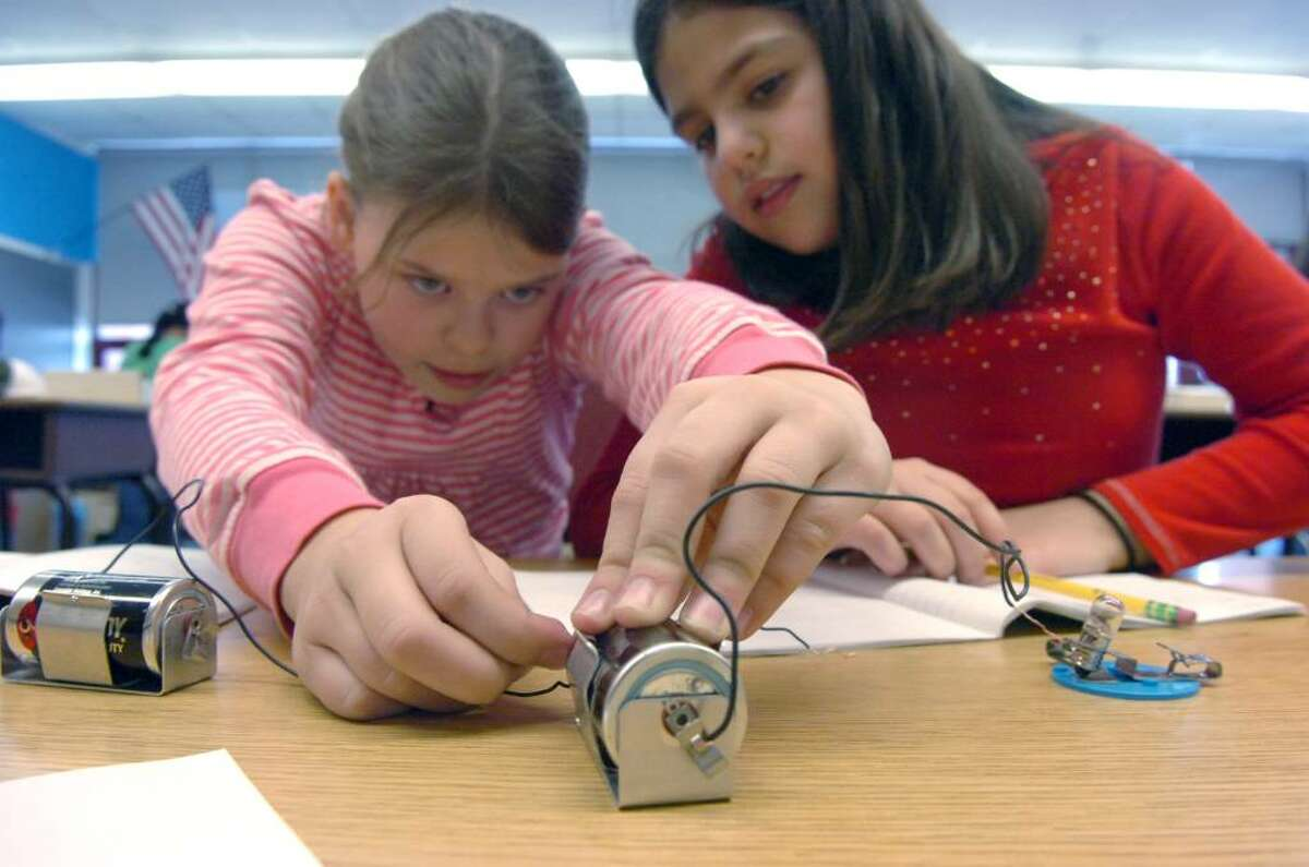 Parkway School students Hattie Pace, left, and Laura Rodrigues investigate the difference between parallel and series circuits during science class Friday afternoon, February 5, 2010. Educators are using a revamped