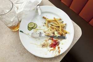 Remains of a satisfying meal on table in diner.