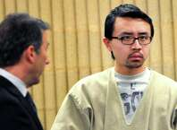 William Dong, right, stands with his lawyer Fred Paoletti Tuesday, Jan. 14, 2014. Dong, the University of New Haven student arrested after his carrying a gun on campus set off a scare was sentenced to 2 years in state prison.