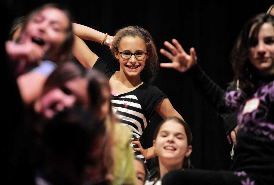 Newtown student Elise Barricelli, 10, from Reed Intermediate School rehearses for a dance program during an after school workshop by the dance company Pilobolus, on Thursday, December 18, 2014, in Newtown, Conn. Photo: H John Voorhees III / The News-Times