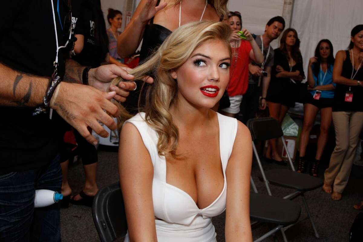 Kate Upton prepares backstage at the Beach Bunny Swimwear show during Mercedes-Benz Fashion Week Swim 2012 at The Raleigh on July 15, 2011 in Miami Beach, Florida. (Photo by Donald Bowers/Getty Images for Make Up For Ever)