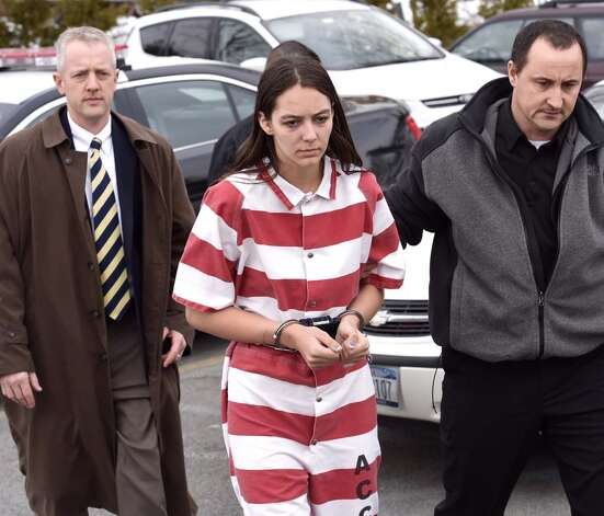 Tiffany VanAlstyne, 19, is led into Knox Town Court on Friday, Dec. 19, 2014, where she was expected to be arraigned on second-degree murder charges in connection with the death of her 5-year-old cousin Kenneth White. (Skip Dickstein / Times Union)