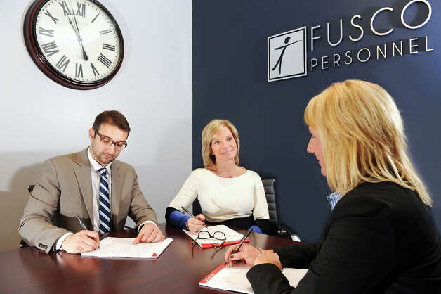 President and CEO Patty Fusco, center, at Fusco Personnel in Albany, N.Y. Photo: Cindy Schultz / Women@Work / 00029374A