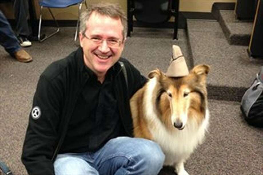Tim Davis, a computer science and engineering professor at Texas A&M University, allowed the school mascot Reveille VIII to help students with a take-home quiz, Dec. 8, 2014. Reveille, an official member of the Corps of Cadets, is shown wearing her handler's cap. (Texas A&M)