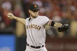 Pitcher Jake Peavy has agreed to a $24 million, two-year contract to stay with the World Series champion San Francisco Giants. (AP / Jeff Roberson)