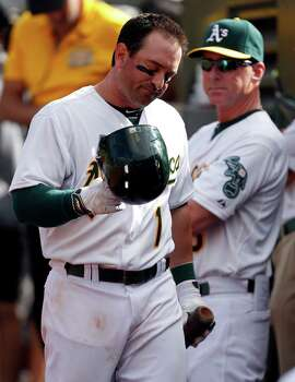Oakland Athletics' Nick Punto returns to dugout after striking out in 9th inning of 5-4 loss to Los Angeles Angels during MLB game at O.co Coliseum  in Oakland, Calif. on Wednesday, September 24, 2014.
