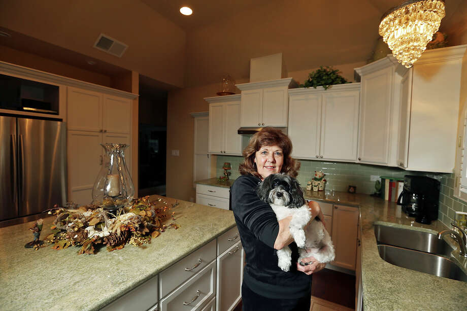 Portrait of Cindy Arnold with her dog Sophie Monday Dec. 8, 2014 in her kitchen. Photo: Edward A. Ornelas, San Antonio Express-News / © 2014 San Antonio Express-News