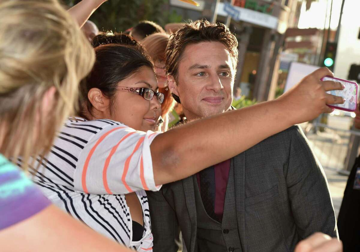 Zach Braff snaps a selfie with a fan.