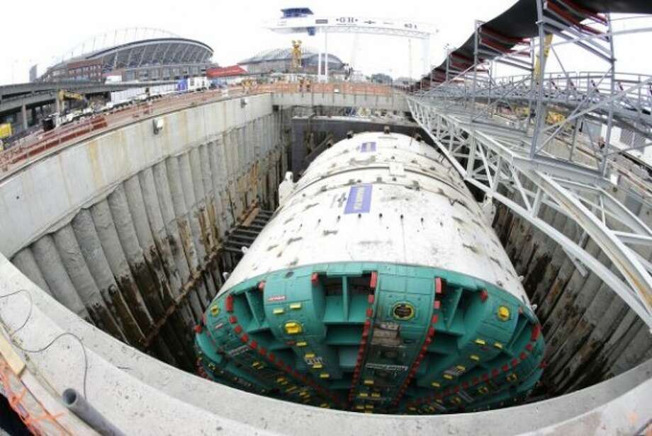 """Like many big cities, Seattle made a lot of """"best"""" and """"worst"""" lists this year. Here's a look at the highlights and lowlights of 2014, starting with the Alaskan Way Viaduct tunnel project. The troubled dig - in which the ground is sinking around stuck tunnel machine Bertha - made U.S. Pirg's 11 biggest """"highway boondoggles."""" Photo: Ted S. Warren, AP. Photo: AP"""