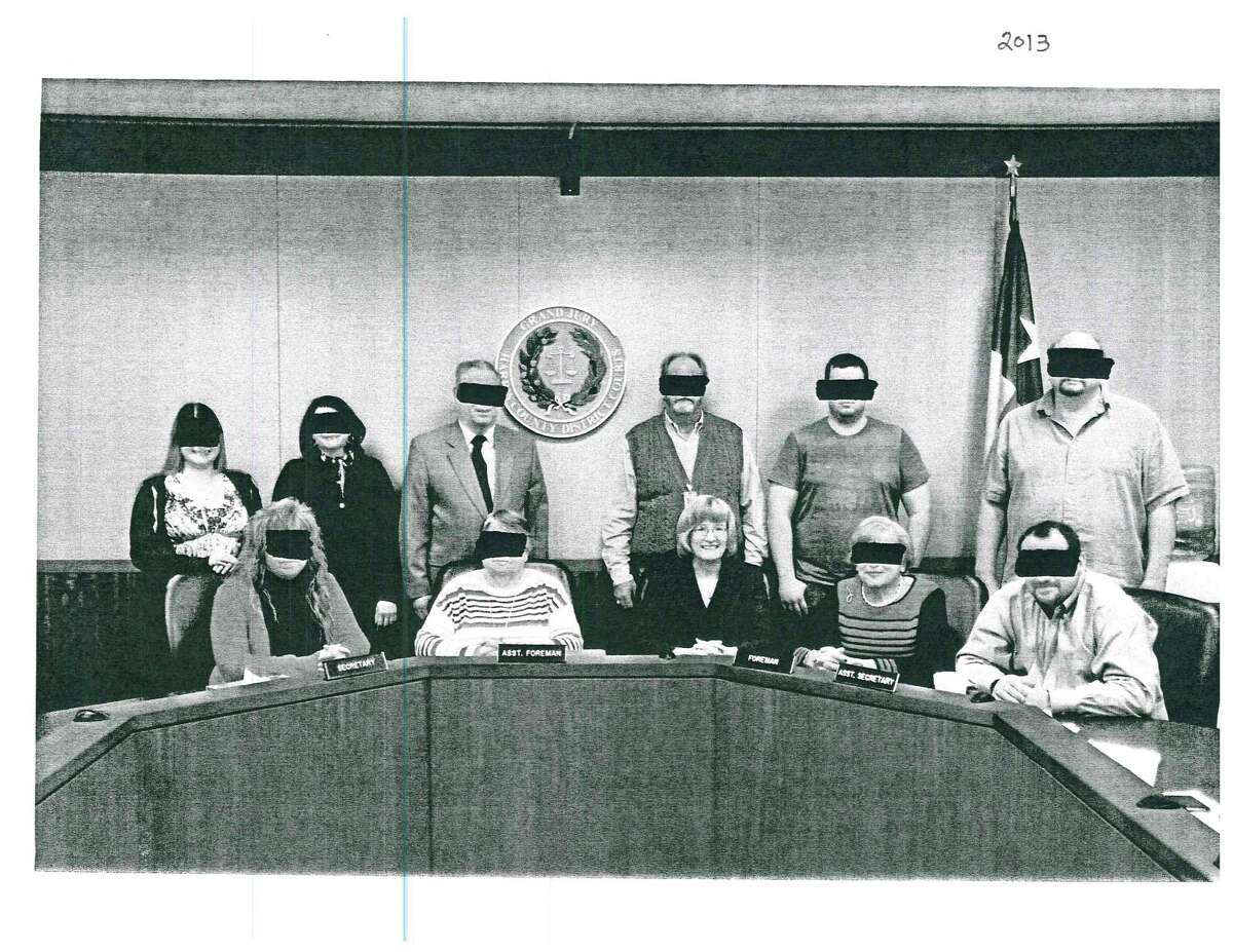 Judge Mary Lou Keel of the 232nd district provided group photos with black bands over the grand jurors' eyes to protect privacy.