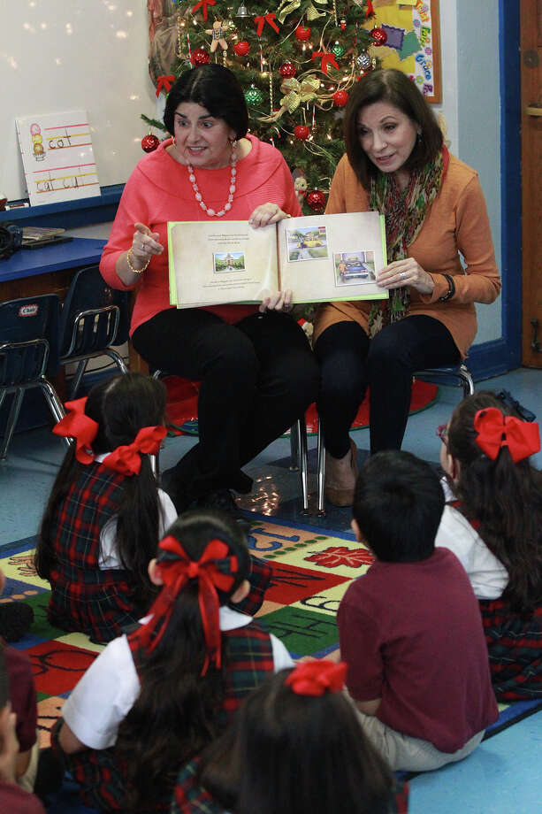 """Writer Diane Gonzales Bertrand (left) and illustrator Thelma Muraida read from their book, """"Cecilia and Miguel Are Best Friends,"""" at Little Flower School, where they met as children. Photo: Photos By John Davenport /San Antonio Express-News / ©San Antonio Express-News/John Davenport"""