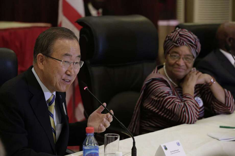 U.N. chief Ban Ki-moon (left) shares a lunch with Liberia's president Ellen Johnson Sirleaf in Monrovia, on the first stop of a visit to Ebola-ravaged west African countries for a first-hand assessment of global efforts to fight the epidemic. Photo: EVAN SCHNEIDER / AFP/Getty Images / AFP