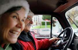 Tracey and Mike Walsh, volunteers with the San Francisco firefighters union's toy program, deliver presents to XXXX in a beat-up 1950 Chevy that was retired in the late '' '' '' ''60s.. Picking up donated barrels of toys, volunteers with the San Francisco Fire Fighters Toy Program Tracey and Mike Walsh drive an antique firetruck through the streets of San Francisco. The 1950 Chevy truck was used by the SFFD to carry salvage covers until it was retired in the late 1960s.