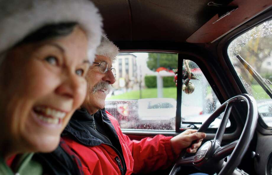 Tracey and Mike Walsh, volunteers with the San Francisco firefighters union's toy program, deliver presents in a beat-up 1950 Chevy truck. Photo: Mike Kepka / The Chronicle / ONLINE_YES