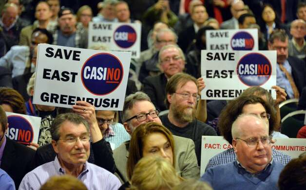 Opponents of an East Greenbush casino listen with bated breath as the New York Gaming Facility Location Board announces their choice for a Capital Region casino site during a meeting Wednesday Dec. 17, 2014, in Albany, NY.   (John Carl D'Annibale / Times Union) Photo: John Carl D'Annibale, Albany Times Union