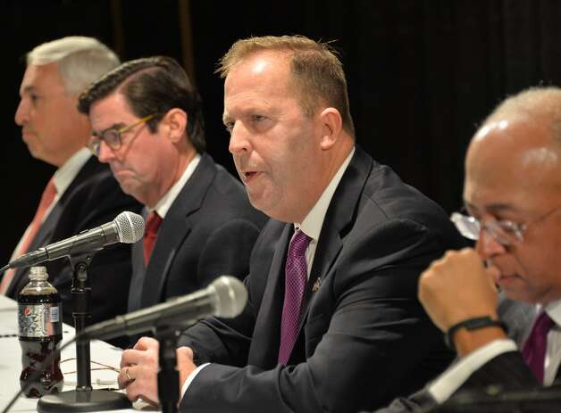New York Gaming Facility Location Board Chairman Kevin Law, center, speaks during a meeting to announce their choices for casino sites Wednesday Dec. 17, 2014, in Albany, NY.   (John Carl D'Annibale / Times Union) Photo: John Carl D'Annibale, Albany Times Union
