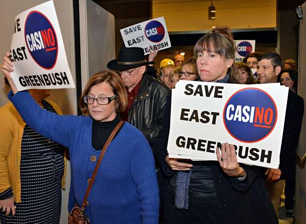 Opponents of the East Greenbush casino site pour into a meeting of the  New York Gaming Facility Location Board Wednesday Dec. 17, 2014, in Albany, NY.   (John Carl D'Annibale / Times Union) Photo: John Carl D'Annibale, Albany Times Union