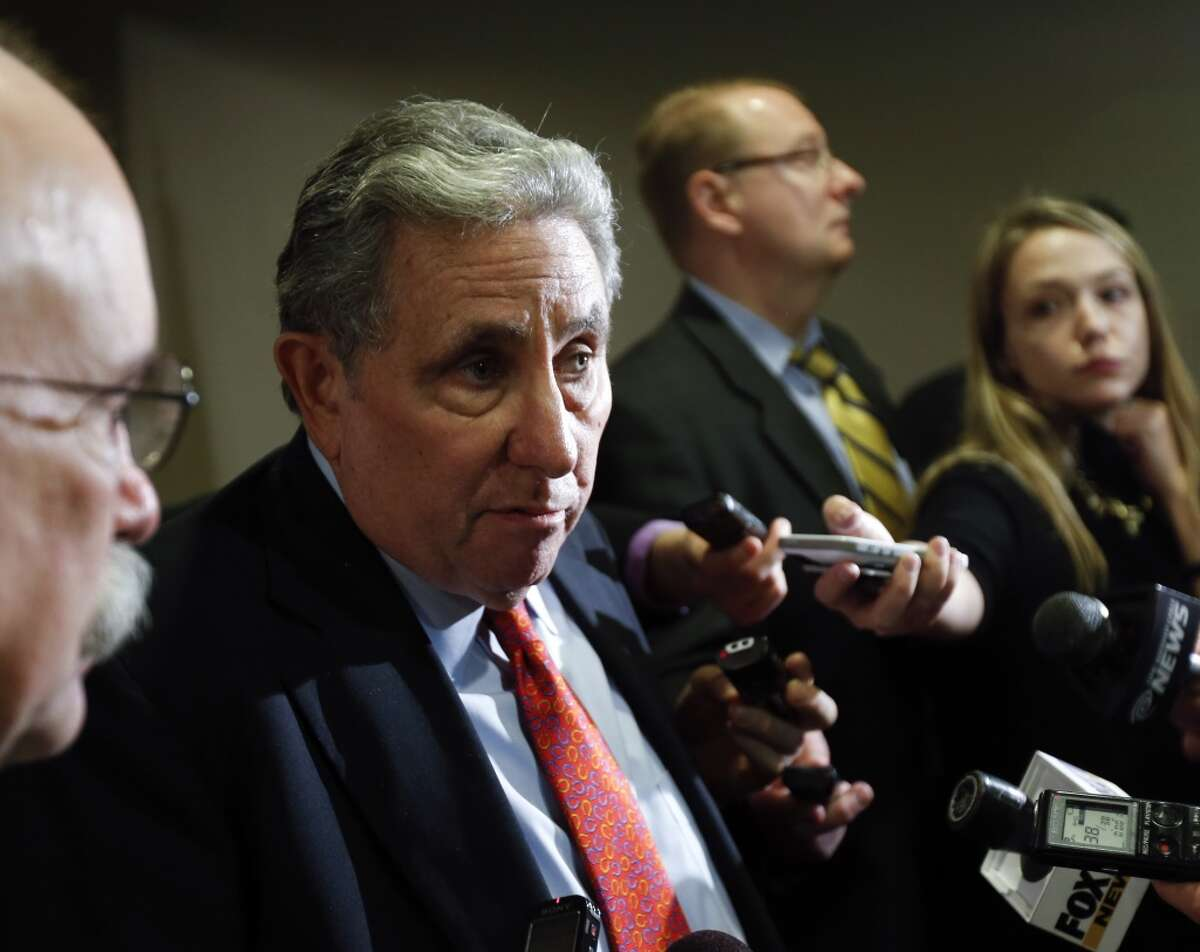 Jeff Gural, owner of Tioga Downs, talks to reporters after a meeting of the Gaming Facility Location Board on Wednesday, Dec. 17, 2014, in Albany, N.Y. Tioga Downs was not recommended for a casino license. (AP Photo/Mike Groll) ORG XMIT: NYMG118