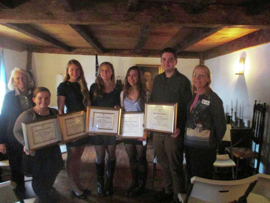Putnam Hill Daughters of the American Revolution (DAR) recently honored the winners of the DAR Good Citizens award with a ceremony and tea hosted by the chapter at Putnam Cottage. Winners were chosen for each of the five Greenwich High School houses by their housemasters, and guidance counselors based on qualities of academics, leadership, service, dependability, and patriotism in their home, school, and community. The award's committee was created by a resolution of the Continental Congress of 1934.  The Good Citizen program is open to senior class students enrolled in accredited private or public high schools in good standing with the state Board of Education. Sherry Dey, Putnam Hill Good Citizens Chairman, and Dorothy Darlington, Regent Putnam Hill DAR, were on hand to give the winners their awards. From left are Kristen Moore, Kylie Ginsberg, Julia Marache, Margaret Keatinge and Jason Bacon. Photo: Contributed Photo / Greenwich Time Contributed