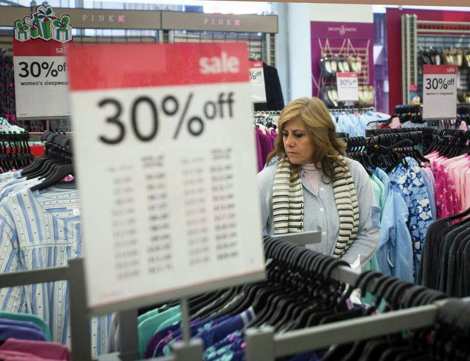 FILE - In this Thursday, Nov. 27, 2014 file photo, Giselle Basurto, of Mexico, shops at a Kmart store in New York on Thanksgiving Day. Retail sales rose 1.8 percent from Nov. 1 through Monday, Dec. 15, 2014 according to data provided from First Data Corp., which tracks purchases at 800,000 stores including online. The modest growth comes despite the heavy discounting customary throughout the season. (AP Photo/John Minchillo) ORG XMIT: NY129 Photo: John Minchillo / FR170537 AP