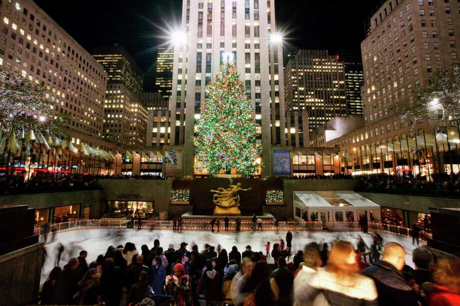 The tree at Rockefeller Center is the center of attention as ice skaters gather below during the holidays. Photo: NYC & Company / Will Steacy