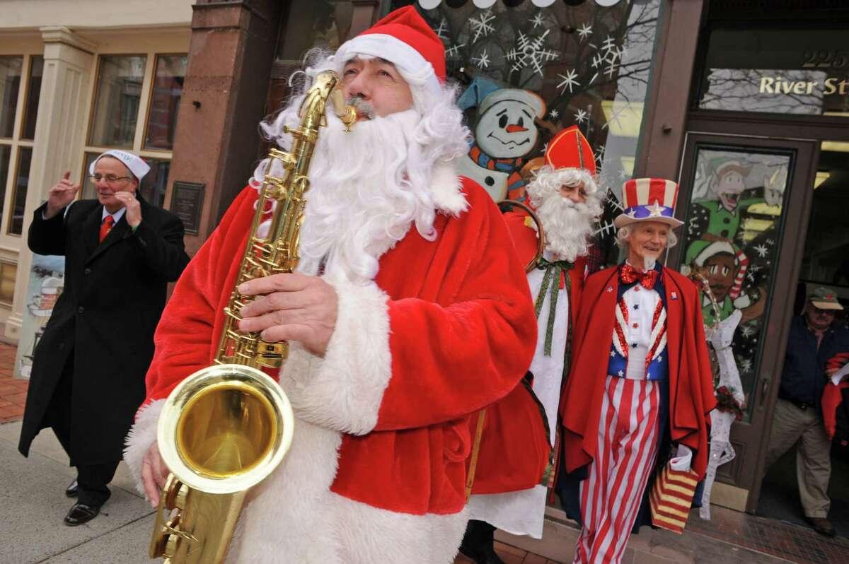 Luke Sax-O-Clausa€ McNamee plays Christmas songs as