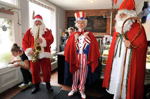 Luke Sax-O-Clausa€ McNamee, left, Uncle Sam Fred Polnisch and Sinterklass a.k.a. St. Nicholas Karl Felsen  visit Sweet Sue's on Friday Dec. 19, 2014 in Troy ,N.Y.  (Michael P. Farrell/Times Union) Photo: Michael P. Farrell / 00029936A